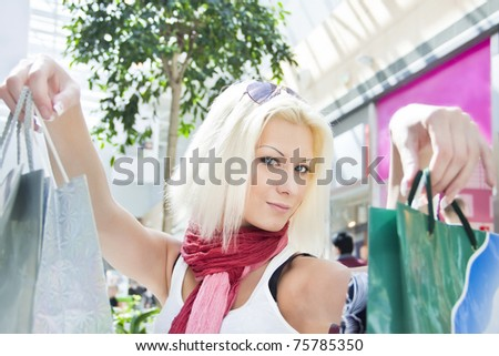 Attractive young beautiful blond Woman with Shopping Bags