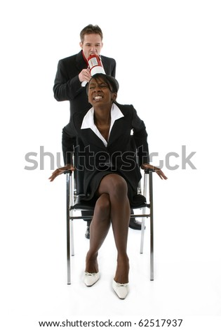 Attractive young black and white business team over white background, Man yelling at woman through megaphone. - stock photo