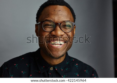 attractive young black male studio smiling at camera and laughing