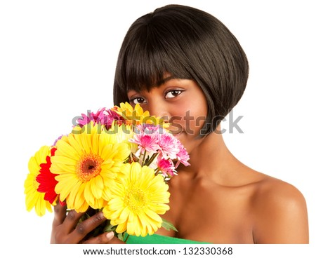 Attractive young black woman holding in hands fresh colorful flowers isolated on white background - stock photo