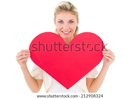 Attractive young blonde showing red heart on white background - stock photo