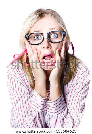 Attractive young blonde woman wearing nerdy glasses reacting in horror and fright with her eyes wide and her hands clawing at her face while her bottom lips juts out in a quiver, isolated portrait