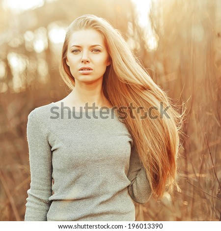 Attractive young blonde woman with perfect long chic hair  - stock photo