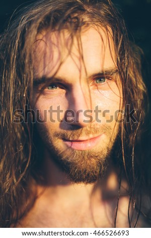 Attractive young boho man outdoors portrait outdoors portrait