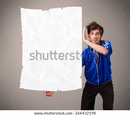 Attractive young boy holding crumpled white paper copy space - stock photo