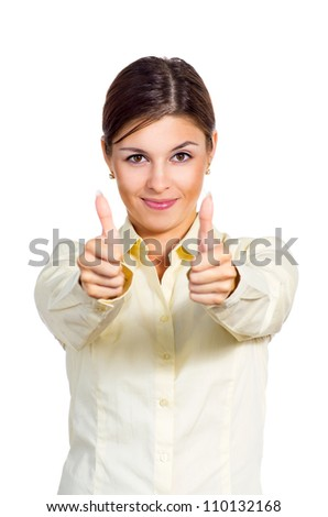 Attractive young brunette businesswoman shows the sign  thumbs up. Isolated against white background. - stock photo