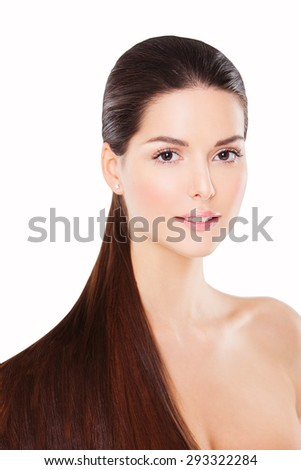 Attractive young brunette with long hair and tail. Healthy hair woman looking at camera - stock photo