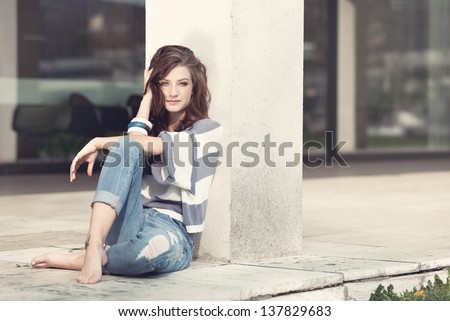 attractive young brunette woman barefoot in summertime outdoor