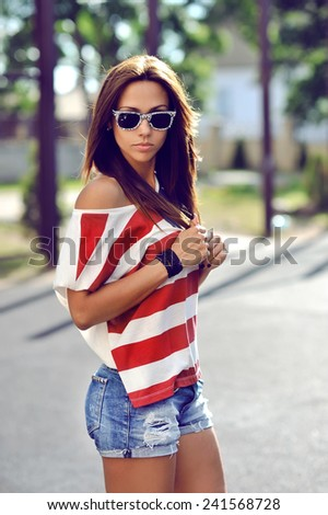 Attractive young brunette woman outdoor fashion portrait  - stock photo