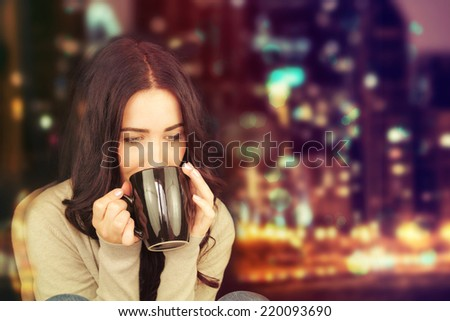 Attractive young brunette woman with mug of hot tea. - stock photo