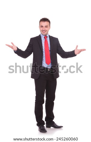 Attractive young business man welcoming you with a big smile on his face. - stock photo
