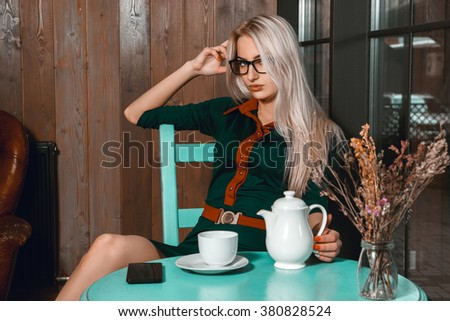 Attractive young business woman have a coffee break in a cafe. Business concept. Business woman in a cafe. Business after hours.