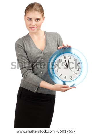 Attractive young business woman holding a big clock, over white background