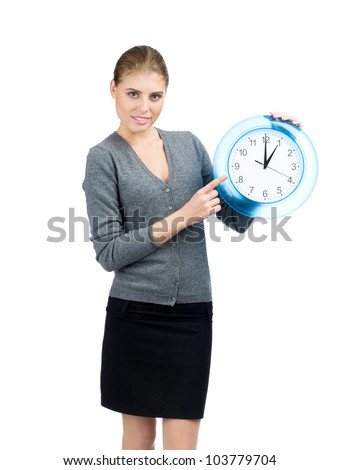 Attractive young business woman holding big clock, over white background