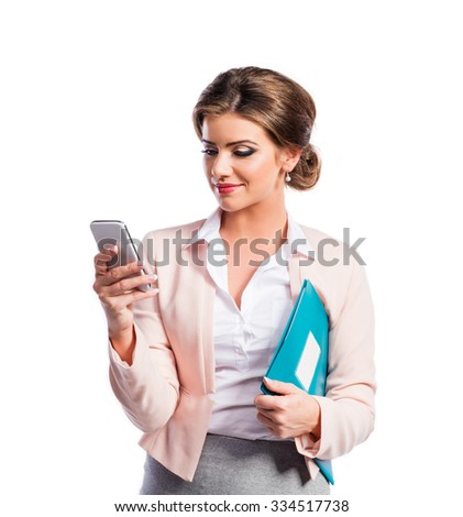 Attractive young business woman. Studio shot on white background.