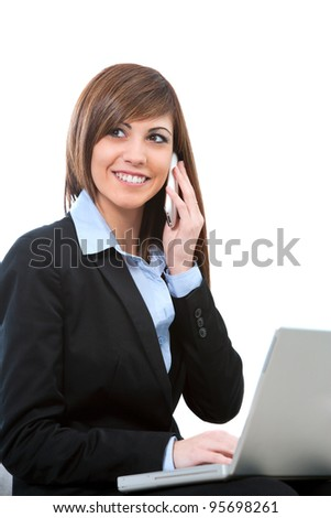 Attractive young business woman talking on cell phone with laptop. Isolated on white.