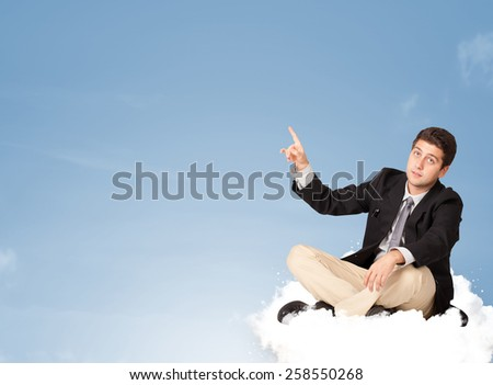 Attractive young businessman sitting on cloud with copy space