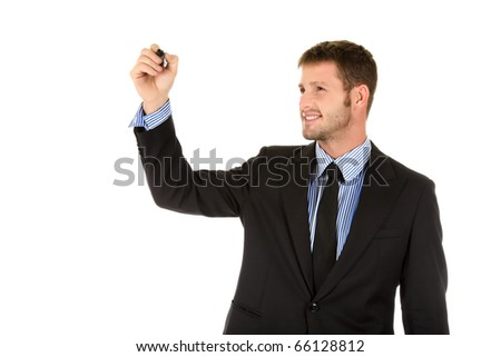 Attractive young businessman with black marker in hand, writing. Studio shot. White background. - stock photo