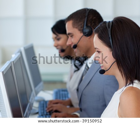 Attractive young businessman working in a call canter