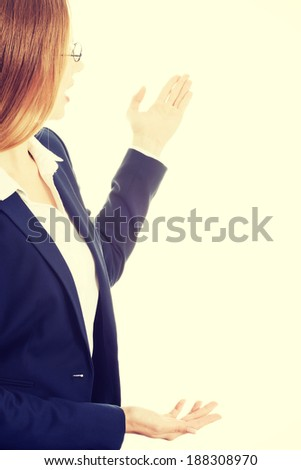 Attractive young businesswoman advertising. Isolated on white. - stock photo