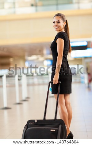 attractive young businesswoman going on business trip at airport - stock photo