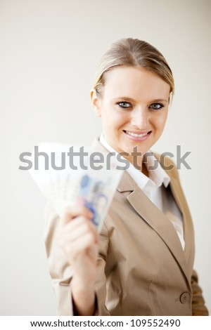 attractive young businesswoman holding south african cash notes - stock photo