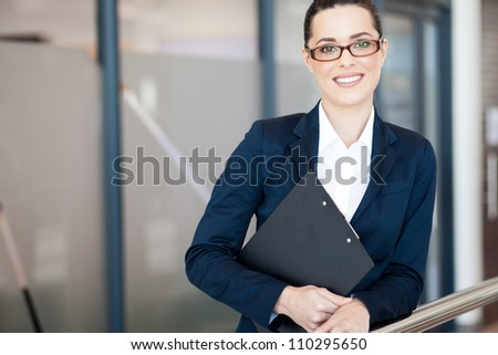 attractive young businesswoman portrait in office - stock photo