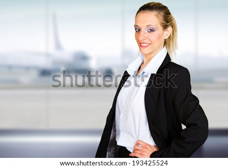 attractive young businesswoman portrait in the airport - stock photo