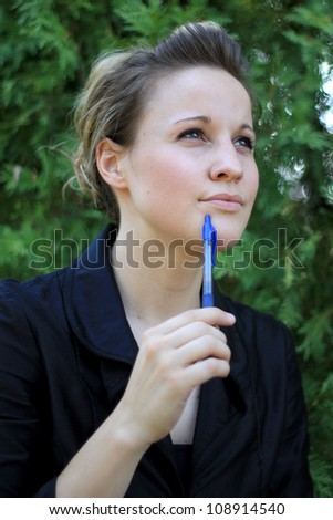 Attractive Young Businesswoman Thinking - stock photo
