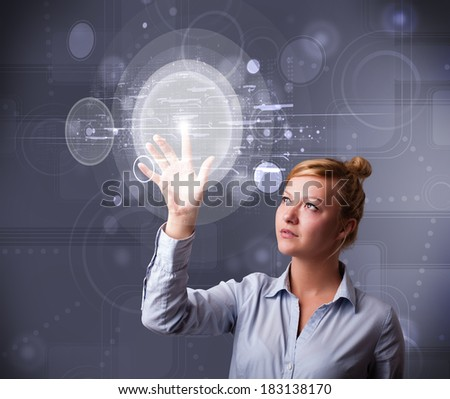 Attractive young businesswoman touching abstract high technology circular buttons