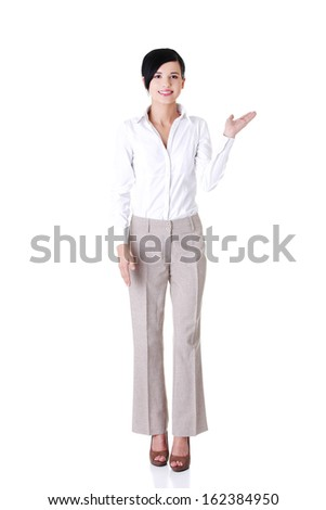 Attractive young businesswoman. Vertical. Front view. Isolated on white.  - stock photo