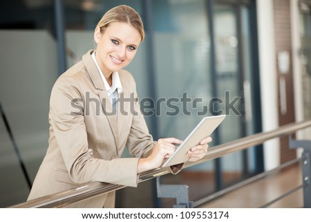 attractive young businesswoman with tablet computer - stock photo