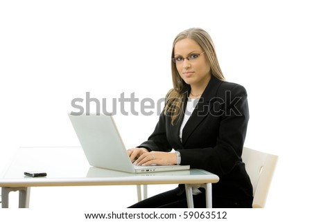 Attractive young businesswoman working on laptop computer at desk, isolated on white background.