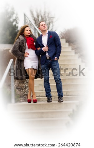 Attractive Young Bussiness Couple Standing On Stairs