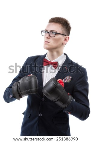 Attractive young caucasian businessman wearing boxing gloves. - stock photo