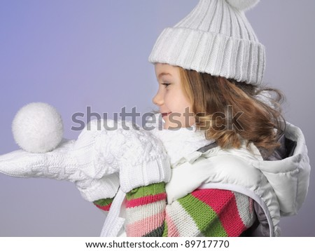 attractive young caucasian girl in warm clothing  in studio isolated on white smiling - stock photo