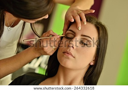 attractive young caucasian woman.beautiful woman with brushes.