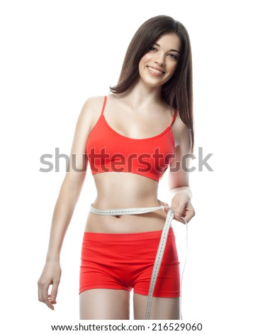 attractive young caucasian woman brunette isolated  on white background studio shot figure body red measuring