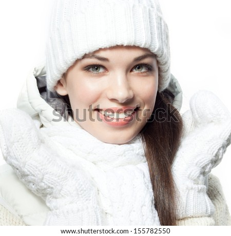 attractive young caucasian woman in warm clothing  in studio isolated on white smiling - stock photo