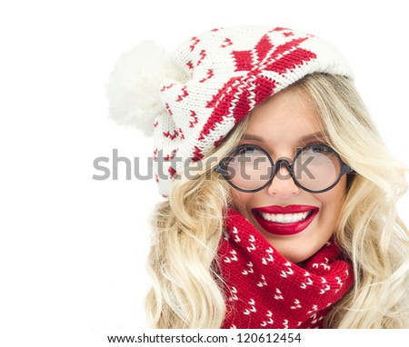 attractive young caucasian woman in warm clothing  in studio isolated on white smiling hat glasses - stock photo