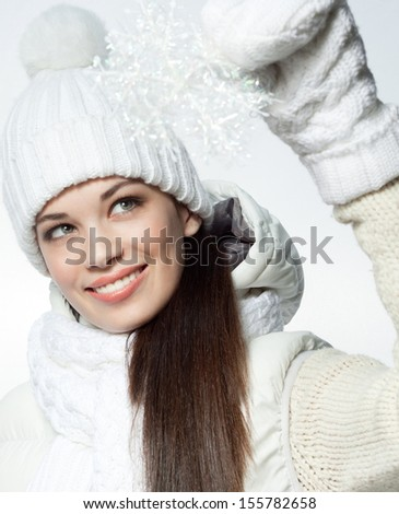 attractive young caucasian woman in warm clothing  in studio smiling - stock photo