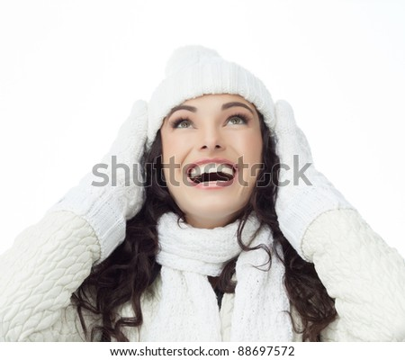 attractive young caucasian woman in warm  clothing smiling