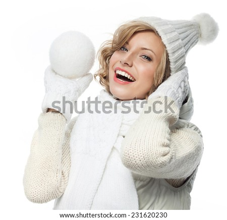 attractive young caucasian woman in warm clothing  studio shot isolated on white smiling winter rose flower with snow ball - stock photo