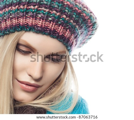 attractive young caucasian woman in warm colorful clothing  studio shot isolated on white - stock photo