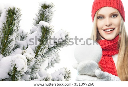attractive young caucasian woman in warm colorful clothing  studio shot isolated on white smiling with snowball christmas tree snow covered new year