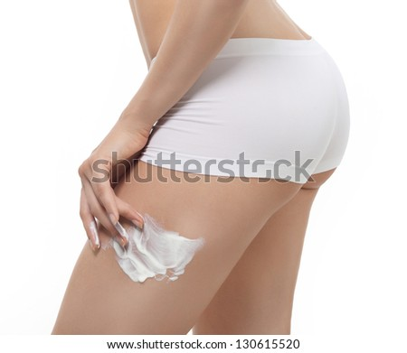 attractive young caucasian woman isolated  on white background studio shot figure body applying cream