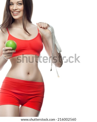 attractive young caucasian woman isolated  on white background studio shot figure body brunette red measuring apple healthy eating