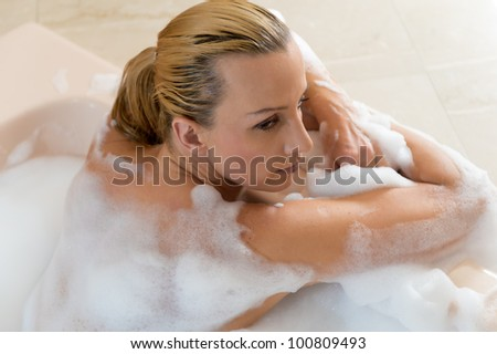 Attractive young caucasian woman taking a bath