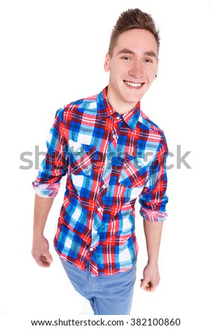 attractive young cheerful man in checked shirt on white background