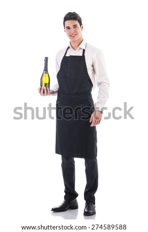 Attractive young chef or waiter holding green champagne bottle isolated in white - stock photo